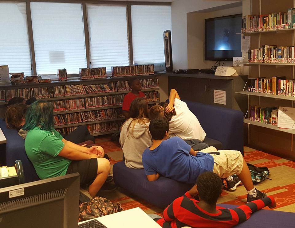 photo of teens hanging out in the teen center playing computer games