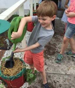 photo of young boy gardening