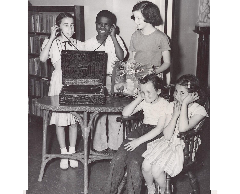 historic photo of children listening to recording