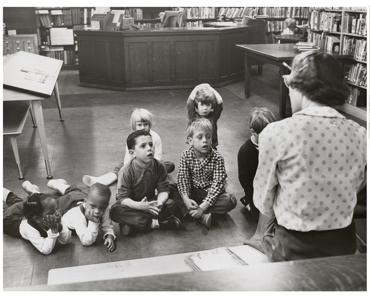 historic photo of children at story time