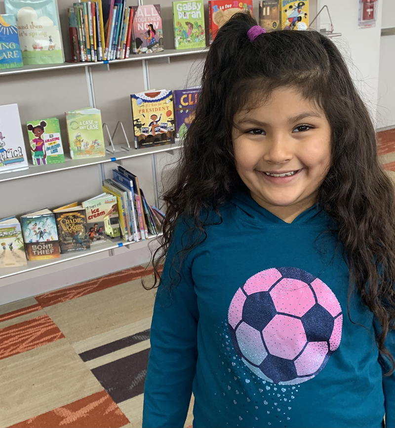 photo of smiling young girl in library
